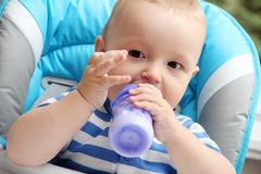 Little boy eats Stock Photo