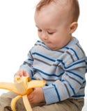 Little boy eats banana Royalty Free Stock Photography