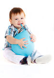 Little boy eats blue baloon Royalty Free Stock Photos