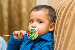 Little boy eats candy Stock Photos