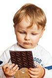 Little boy eats chocolate Royalty Free Stock Photography