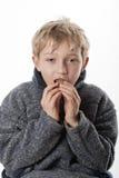 Little boy eats an easter egg Stock Images