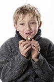 Little boy eats an easter egg Stock Image