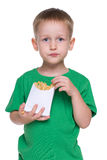 Little boy eats fries Royalty Free Stock Image
