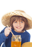 Little boy eats honey Stock Photos