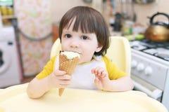 Little boy eats ice-cream cone Royalty Free Stock Photography