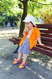 Little boy eats ice-cream in summer outdoors Stock Photography