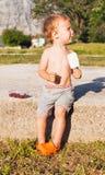 The little boy eats ice-cream Stock Photos