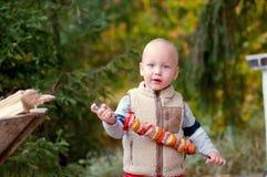 Little boy eats kebab outdoors Stock Photo