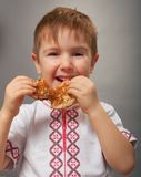 Little boy eats pancakes Royalty Free Stock Photos