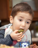 Little boy eats pickles Stock Images