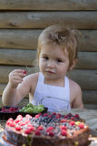 Little boy eats red raspberry Royalty Free Stock Images
