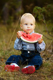 Little boy eats watermelon Stock Image