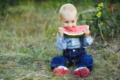 Little boy eats watermelon Royalty Free Stock Photo
