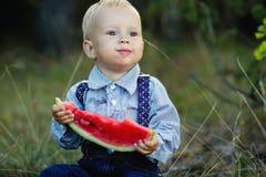 Little boy eats watermelon Royalty Free Stock Photos