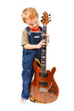Little boy with electric guitar Stock Image