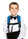 Little boy elementary student. With laptop, backpack and bowtie isolated on white Stock Image