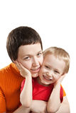 The little boy embraces mum. The little boy presses a mum's head to his face Royalty Free Stock Photo