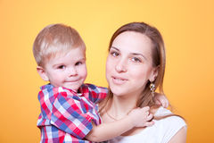 Little boy embracing his smiling mother Stock Photography