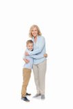 Little boy embracing with mother. Isolated on white stock photography