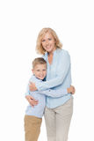 Little boy embracing with mother. Isolated on white stock image