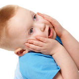 Little boy emotionally grabbed hold of face Stock Photo