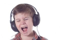 The little boy emotionally listens to music stock photography