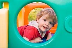 Little Boy en diapositiva Foto de archivo libre de regalías