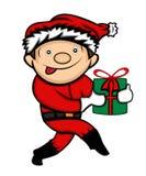 Little Boy en Santa Claus Costume Sneaking Image stock