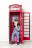 Little boy in English red phone Stock Photos