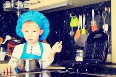 Little boy enjoy cooking in kitchen Stock Image