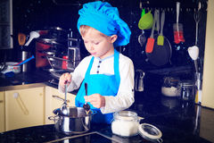 Little boy enjoy cooking in kitchen Stock Images