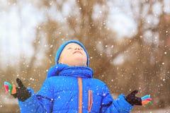 Little boy enjoy first snow in winter nature Stock Photo