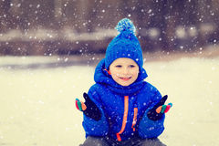 Little boy enjoy first snow in winter nature Stock Photo