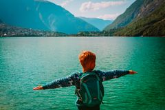 Little boy enjoy hiking travel in nature, at mountain lake. Norway travel royalty free stock images