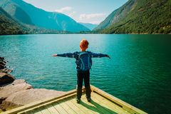 Little boy enjoy hiking travel in nature, at mountain lake. Norway travel royalty free stock photos