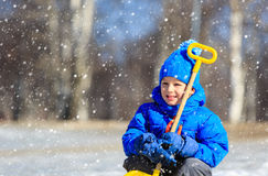 Little boy enjoy playing in winter snow Royalty Free Stock Image