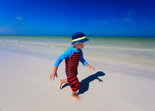 Little boy enjoy running on summer beach Stock Photography