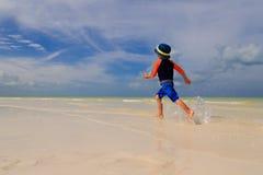 Little boy enjoy running on summer beach Stock Photo
