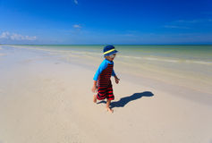 Little boy enjoy running on summer beach Royalty Free Stock Images