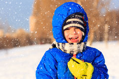 Little boy enjoy snow in winter nature Stock Photos