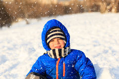 Little boy enjoy snow in winter nature Royalty Free Stock Photo