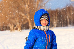 Little boy enjoy snow in winter nature Royalty Free Stock Images