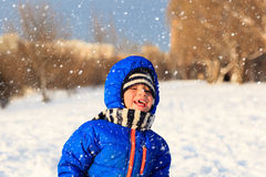 Little boy enjoy snow in winter nature Stock Photography
