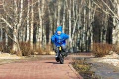 Little boy enjoying bike ride in spring Stock Photo