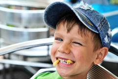 Little boy enjoying french fries Stock Image