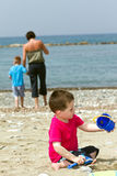 Little boy enjoying his holiday. Little boy having fun on summer beach holiday Royalty Free Stock Photos