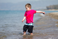 Little boy enjoying his holiday. Little boy having fun on summer beach holiday Royalty Free Stock Image