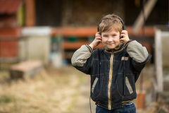 Little boy enjoying music with headphones Royalty Free Stock Photo
