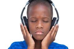 Little boy enjoying music Royalty Free Stock Photography